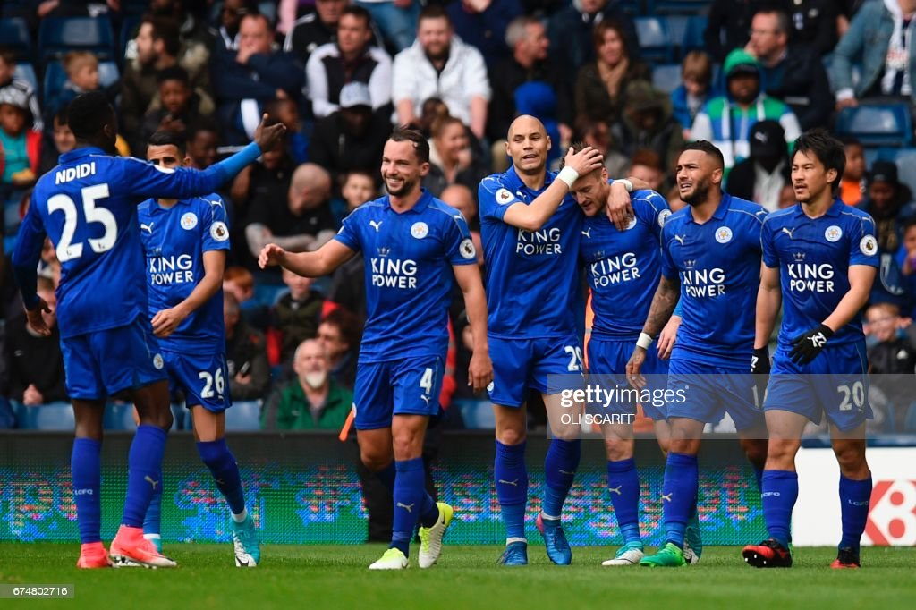 Leicester City's English striker Jamie Vardy (3R) is congratulated after scoring the opening goal during the English Premier League football match between West Bromwich Albion and Leicester City at The Hawthorns stadium in West Bromwich, central England, on April 29, 2017. PHOTO / Oli SCARFF / RESTRICTED TO EDITORIAL USE. No use with unauthorized audio, video, data, fixture lists, club/league logos or 'live' services. Online in-match use limited to 75 images, no video emulation. No use in betting, games or single club/league/player publications. /