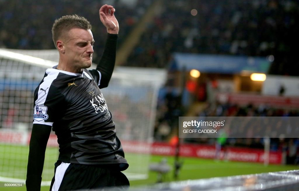 Leicester City's English striker Jamie Vardy kicks the advertising boards in frustration after missing a goal opportunity during the English Premier League football match between Swansea City and Leicester City at The Liberty Stadium in Swansea, south Wales on December 5, 2015. AFP PHOTO / GEOFF CADDICK USE. No use with unauthorized audio, video, data, fixture lists, club/league logos or 'live' services. Online in-match use limited to 75 images, no video emulation. No use in betting, games or single club/league/player publications. /