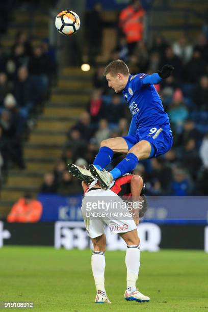 Leicester City's English striker Jamie Vardy leaps over Sheffield United's English defender George Baldock during the English FA Cup fifth round...