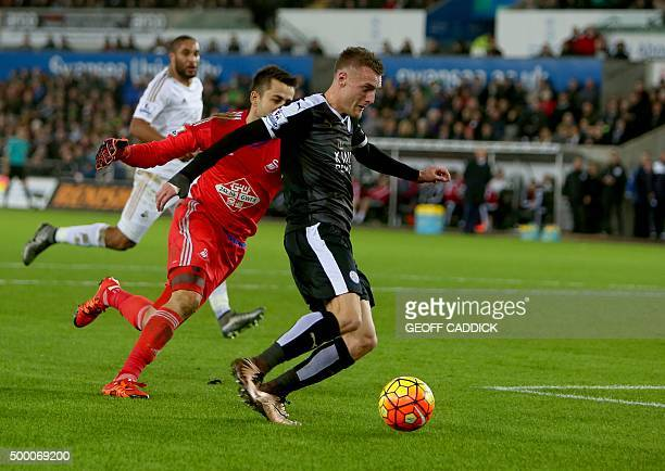 Leicester City's English striker Jamie Vardy rounds Swansea City`s Polish goalkeeper Lukasz Fabianski but shoots wide during the English Premier...