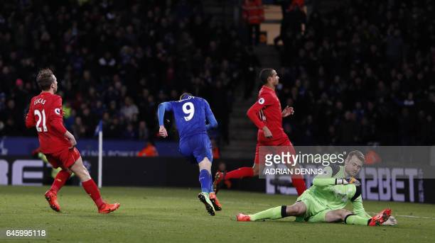 Leicester City's English striker Jamie Vardy runs to celebrate after scoring their first goal during the English Premier League football match...