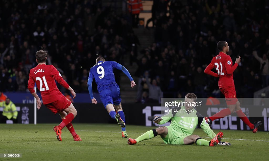 Leicester City's English striker Jamie Vardy (2L) runs to celebrate after scoring their first goal during the English Premier League football match between Leicester City and Liverpool at King Power Stadium in Leicester, central England on February 27, 2017. / AFP / ADRIAN DENNIS / RESTRICTED TO EDITORIAL USE. No use with unauthorized audio, video, data, fixture lists, club/league logos or 'live' services. Online in-match use limited to 75 images, no video emulation. No use in betting, games or single club/league/player publications. /