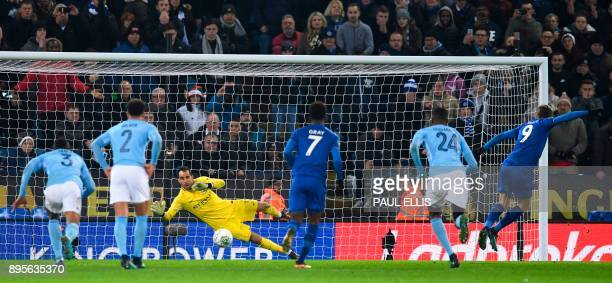 Leicester City's English striker Jamie Vardy scores an equalising goal from the penalty spot to make the score 11 during the English League Cup...
