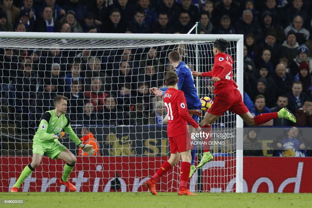 Leicester City's English striker Jamie Vardy (2R) scores his team's third goal during the English Premier League football match between Leicester City and Liverpool at King Power Stadium in Leicester, central England on February 27, 2017. / AFP / ADRIAN DENNIS / RESTRICTED TO EDITORIAL USE. No use with unauthorized audio, video, data, fixture lists, club/league logos or 'live' services. Online in-match use limited to 75 images, no video emulation. No use in betting, games or single club/league/player publications. /