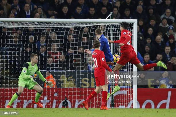 Leicester City's English striker Jamie Vardy scores his team's third goal during the English Premier League football match between Leicester City and...