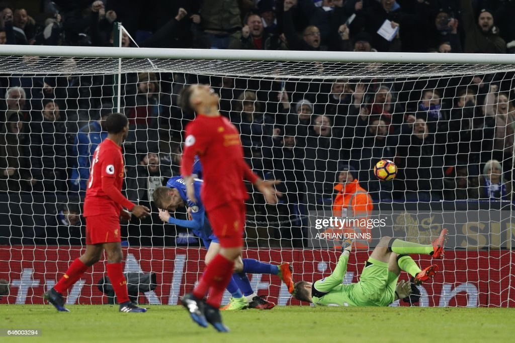 Leicester City's English striker Jamie Vardy (2L) scores his team's third goal during the English Premier League football match between Leicester City and Liverpool at King Power Stadium in Leicester, central England on February 27, 2017. / AFP / ADRIAN DENNIS / RESTRICTED TO EDITORIAL USE. No use with unauthorized audio, video, data, fixture lists, club/league logos or 'live' services. Online in-match use limited to 75 images, no video emulation. No use in betting, games or single club/league/player publications. /
