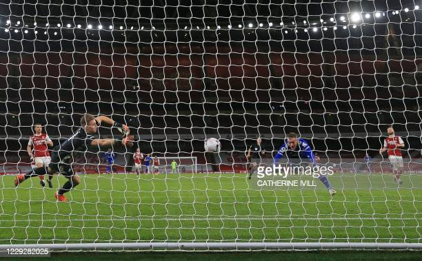 Leicester City's English striker Jamie Vardy scores the opening goal past Arsenal's German goalkeeper Bernd Leno during the English Premier League...