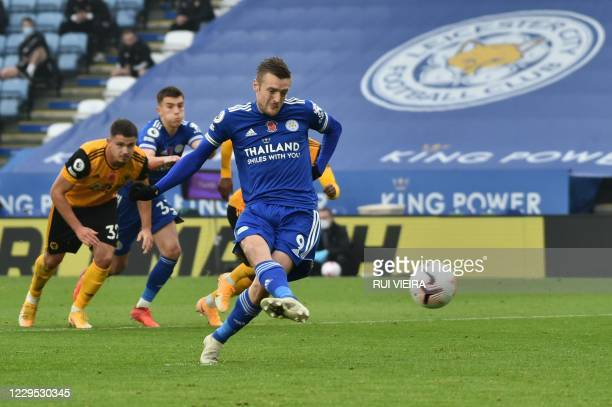 Leicester City's English striker Jamie Vardy scores the opening goal from the penalty spot during the English Premier League football match between...