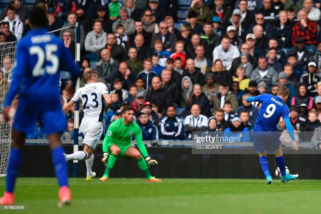Leicester City's English striker Jamie Vardy (R) scores the opening goal during the English Premier League football match between West Bromwich Albion and Leicester City at The Hawthorns stadium in West Bromwich, central England, on April 29, 2017. PHOTO / Oli SCARFF / RESTRICTED TO EDITORIAL USE. No use with unauthorized audio, video, data, fixture lists, club/league logos or 'live' services. Online in-match use limited to 75 images, no video emulation. No use in betting, games or single club/league/player publications. /