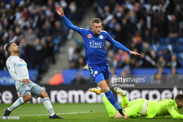 Leicester City's English striker Jamie Vardy scores the team's first goal during the English Premier League football match between Leicester City and...