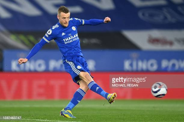 Leicester City's English striker Jamie Vardy shoots to score the opening goal of the English Premier League football match between Leicester City and...