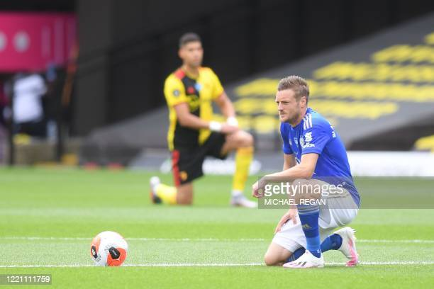 Leicester City's English striker Jamie Vardy takes a knee to show support for the Black Lives Matter movement and as a protest against racism before...