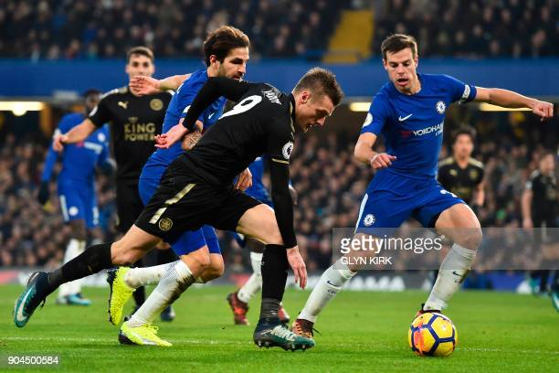 Leicester City's English striker Jamie Vardy takes on Chelsea's Spanish midfielder Cesc Fabregas an Chelsea's Spanish defender Cesar Azpilicueta...