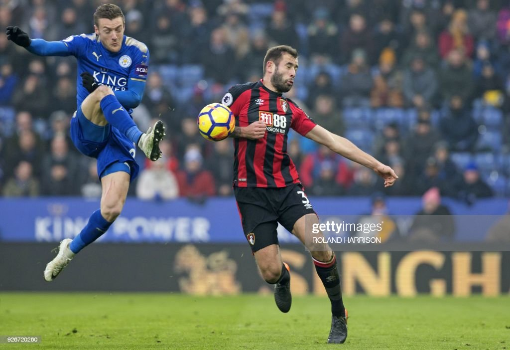 Leicester City's English striker Jamie Vardy (L) vies with Bournemouth's English defender Steve Cook during the English Premier League football match between Leicester City and Bournemouth at King Power Stadium in Leicester, central England on March 3, 2018. / AFP PHOTO / Roland HARRISON / RESTRICTED TO EDITORIAL USE. No use with unauthorized audio, video, data, fixture lists, club/league logos or 'live' services. Online in-match use limited to 75 images, no video emulation. No use in betting, games or single club/league/player publications. /