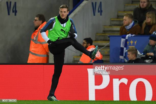 Leicester City's English striker Jamie Vardy warms up on the sidelines during the English FA Cup third round replay football match between Leicester...