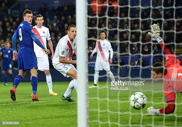 Leicester City's English striker Jamie Vardy watches as Club Brugge's French goalkeeper Ludovic Butelle fails to save his shot during the UEFA...