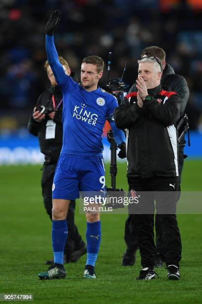 Leicester City's English striker Jamie Vardy waves at the final whistle during the English FA Cup third round replay football match between Leicester...