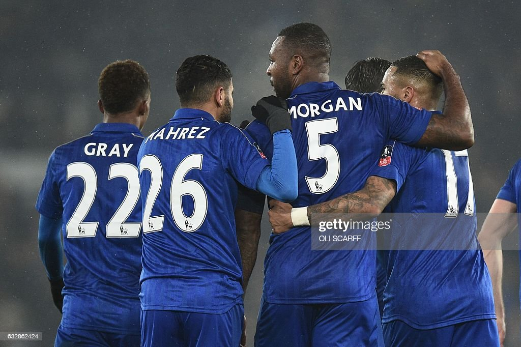 Leicester City's English-born Jamaican defender Wes Morgan (2R) celebrates with Leicester City's English midfielder Demarai Gray (L), Leicester City's Algerian midfielder Riyad Mahrez (2L) and Leicester City's English defender Danny Simpson (R) after scoring their second goal during the English FA Cup fourth round football match between Derby County and Leicester City at Pride Park Stadium in Derby, central England on January 27, 2017. / AFP / Oli SCARFF / RESTRICTED TO EDITORIAL USE. No use with unauthorized audio, video, data, fixture lists, club/league logos or 'live' services. Online in-match use limited to 75 images, no video emulation. No use in betting, games or single club/league/player publications. /
