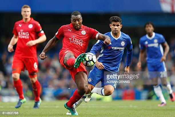 Leicester City's Englishborn Jamaican defender Wes Morgan clears the ball during the English Premier League football match between Chelsea and...