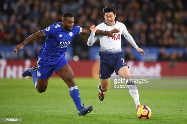Leicester City's Englishborn Jamaican defender Wes Morgan vies with Tottenham Hotspur's South Korean striker Son HeungMin during the English Premier...