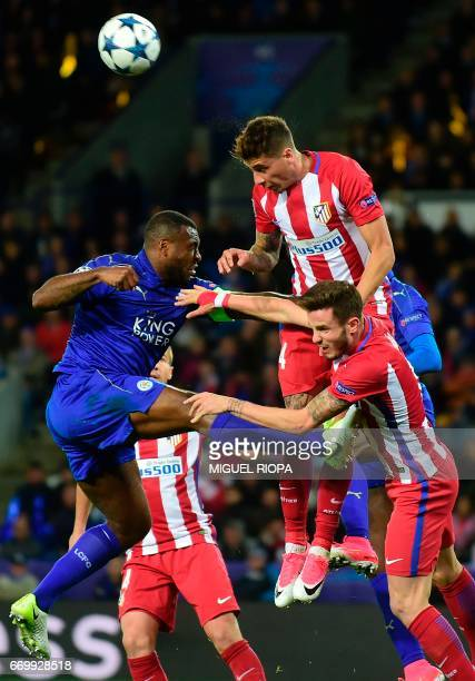 Leicester City's Englishborn Jamaican defender Wes Morgan vies with Atletico Madrid's Uruguayan defender Jose Maria Gimenez during the UEFA Champions...