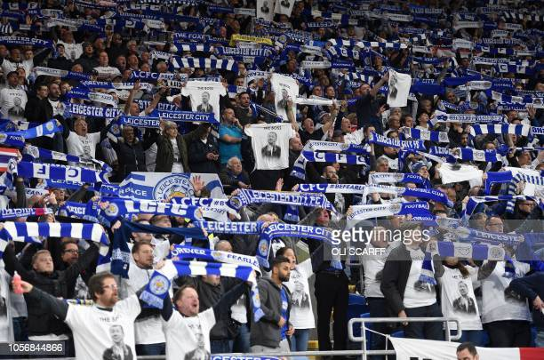 Leicester City's fans pay tribute to Leicester City Chairman Vichai Srivaddhanaprabha as they celebrate English midfielder Demarai Gray's goal during...