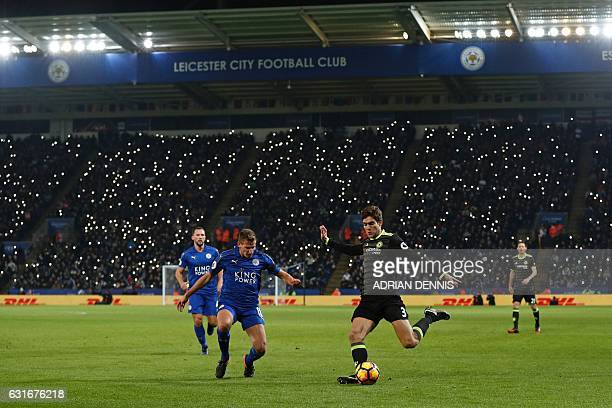 Leicester City's fans shine their mobile phones as lights in support of former player Alan Birchenall who was taken ill earlier this week during the...