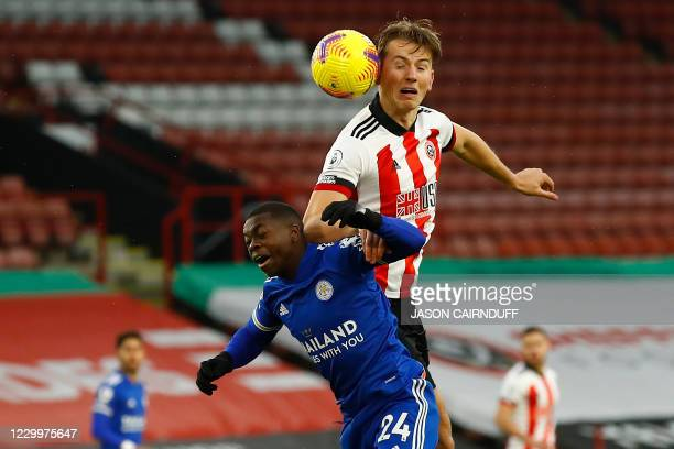 Leicester City's French midfielder Nampalys Mendy and Sheffield United's Norwegian midfielder Sander Berge go up for a header during the English...