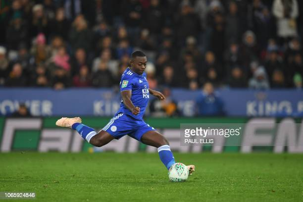 TOPSHOT Leicester City's French midfielder Nampalys Mendy shoots from the penalty spot to score his team's sixth penalty during the rescheduled...