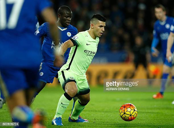 Leicester City's French midfielder N'Golo Kante vies with Manchester City's Argentinian striker Sergio Aguero during the English Premier League...
