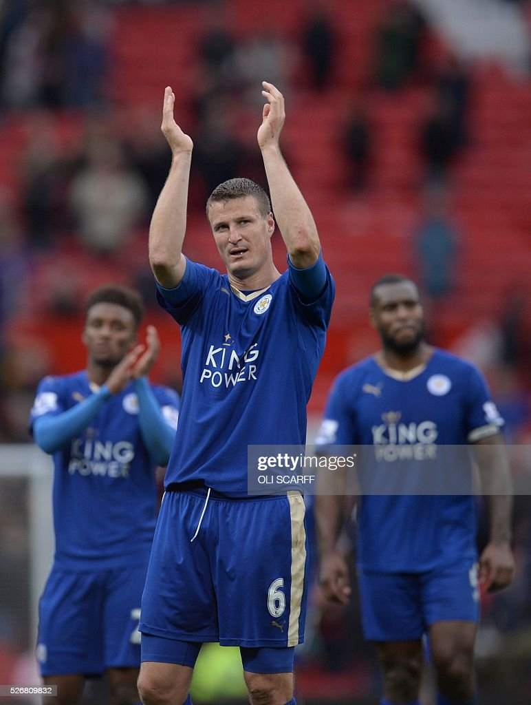 Leicester City's German defender Robert Huth (C) applauds fans after the English Premier League football match between Manchester United and Leicester City at Old Trafford in Manchester, north west England, on May 1, 2016. / AFP / OLI SCARFF / RESTRICTED TO EDITORIAL USE. No use with unauthorized audio, video, data, fixture lists, club/league logos or 'live' services. Online in-match use limited to 75 images, no video emulation. No use in betting, games or single club/league/player publications. /
