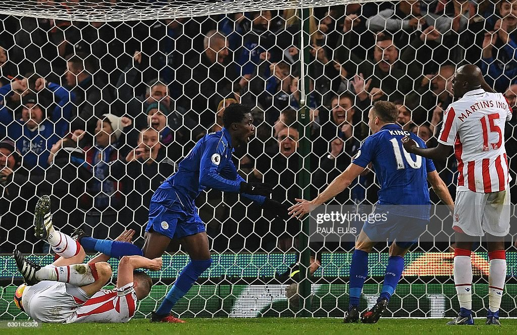 Leicester City's Ghanaian midfielder Daniel Amartey (2L) celebrates scoring his team's second goal during the English Premier League football match between Stoke City and Leicester City at the Bet365 Stadium in Stoke-on-Trent, central England on December 17, 2016. / AFP / Paul ELLIS / RESTRICTED TO EDITORIAL USE. No use with unauthorized audio, video, data, fixture lists, club/league logos or 'live' services. Online in-match use limited to 75 images, no video emulation. No use in betting, games or single club/league/player publications. /