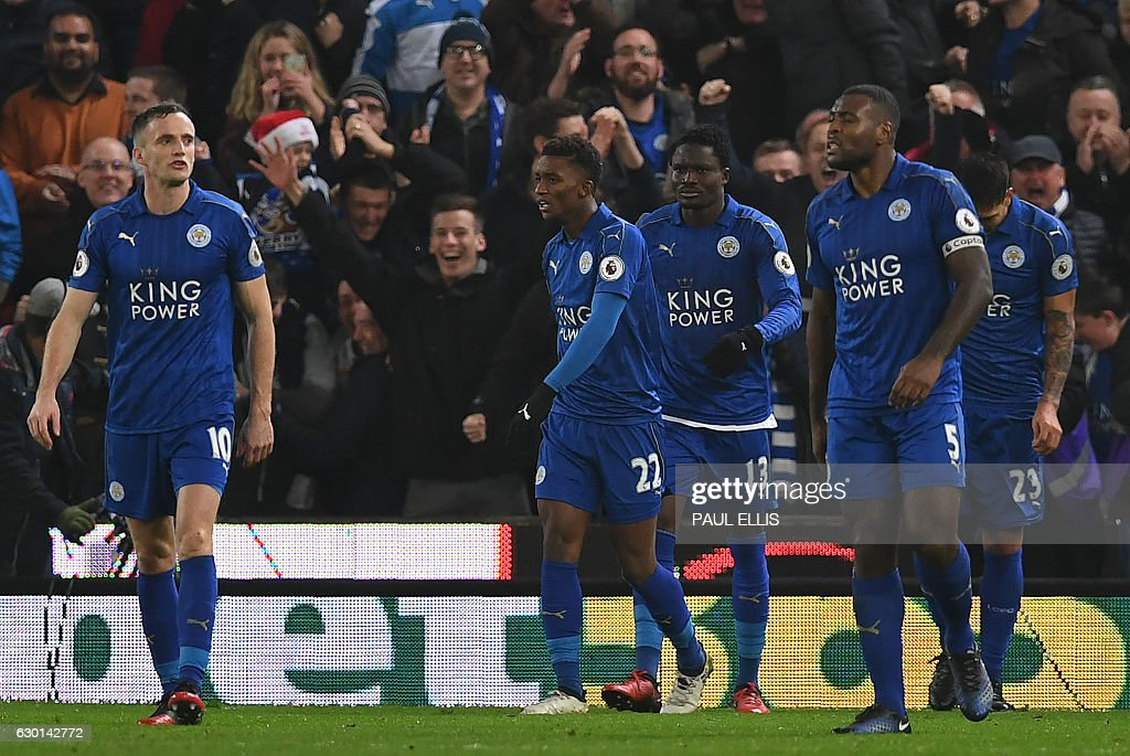 Leicester City's Ghanaian midfielder Daniel Amartey (C) celebrates scoring his team's second goal during the English Premier League football match between Stoke City and Leicester City at the Bet365 Stadium in Stoke-on-Trent, central England on December 17, 2016. The match ended in a draw at 2-2. / AFP / Paul ELLIS / RESTRICTED TO EDITORIAL USE. No use with unauthorized audio, video, data, fixture lists, club/league logos or 'live' services. Online in-match use limited to 75 images, no video emulation. No use in betting, games or single club/league/player publications. /