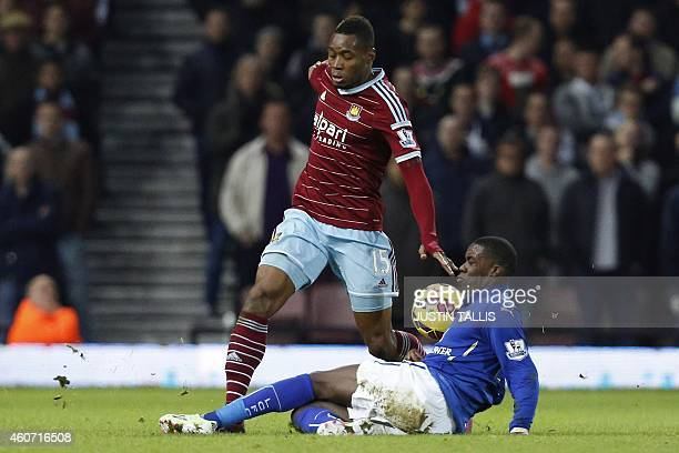 Leicester City's Ghanaian striker Jeff Schlupp vies with West Ham United's Senegalese striker Diafra Sakho during the English Premier League football...