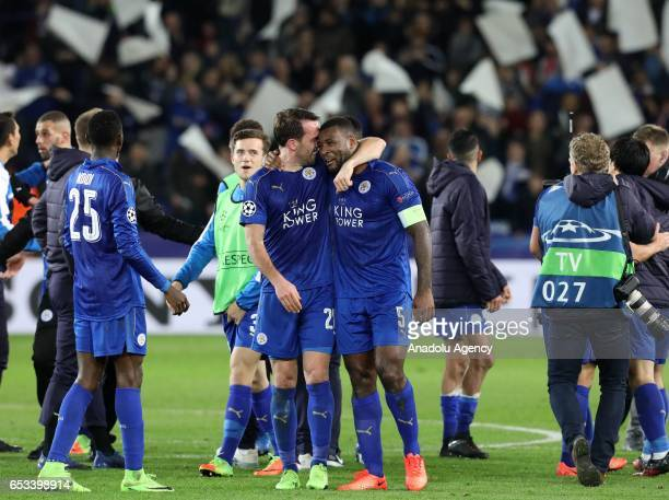 Leicester City's goal scorer and captain defender Wes Morgan celebrates with team mate Leicester City's defender Christian Fuchs after the final...