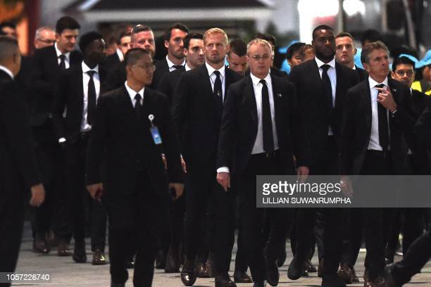 TOPSHOT Leicester City's goalkeeper Kasper Schmeichel manager Claude Puel with other team members and officials arrive at Wat Thepsirin Buddhist...