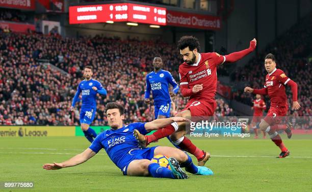 Leicester City's Harry Maguire and Liverpool's Mohamed Salah battle for the ball during the Premier League match at Anfield Liverpool