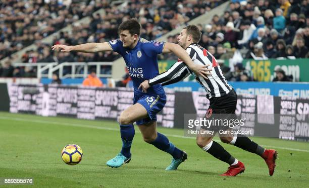 Leicester City's Harry Maguire holds off the challenge from Newcastle United's Florian Lejeune during the Premier League match between Newcastle...