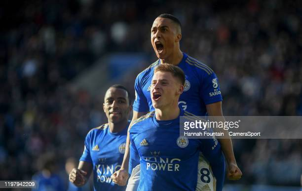 Leicester City's Harvey Barnes celebrates scoring his side's first goal with team mate Youri Tielemans during the Premier League match between...