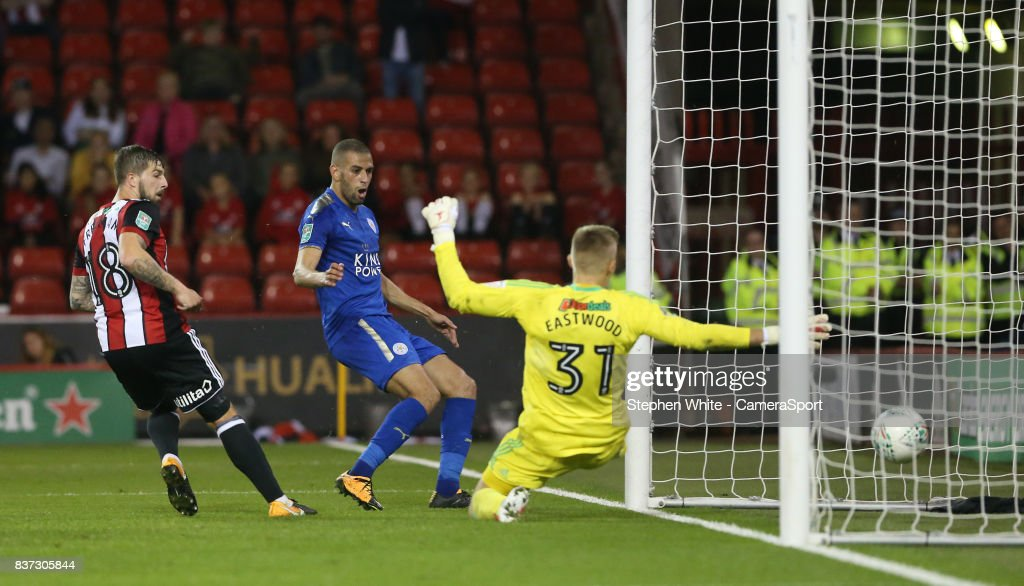 Leicester City's Islam Slimani scores his second and his side's third goal slotting the ball past Sheffield United's goalkeeper Jake Eastwood during the Carabao Cup Second Round match between Sheffield United and Leicester City at Bramall Lane on August 22, 2017 in Sheffield, England.