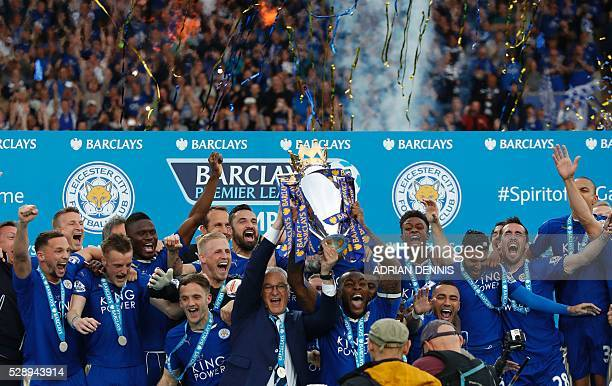 Leicester City's Italian manager Claudio Ranieri and Leicester City's English defender Wes Morgan hold up the Premier league trophy after winning the...