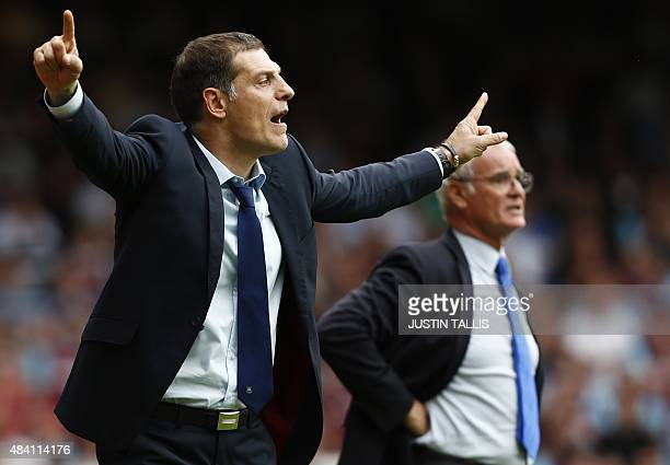 Leicester City's Italian manager Claudio Ranieri and West Ham United's Croatian manager Slaven Bilic watch the action during the English Premier...