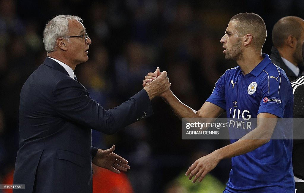 Leicester City's Italian manager Claudio Ranieri (L) congratulates Leicester City's Algerian striker Islam Slimani as he leaves the pitch during the UEFA Champions League group G football match between Leicester City and Porto at the King Power Stadium in Leicester, central England on Septmeber 27, 2016. Leicester won the match 1-0. / AFP / Adrian DENNIS