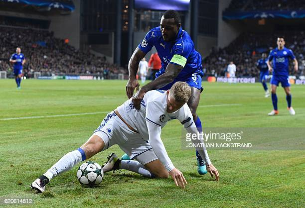 Leicester City's Jamaican defender Wes Morgan vies with FC Copenhagen's Danish forward Andreas Cornelius during the UEFA Champions League group G...