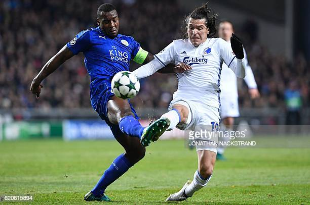 Leicester City's Jamaican defender Wes Morgan vies with FC Copenhagen's Paraguayan forward Federico Santander during the UEFA Champions League group...