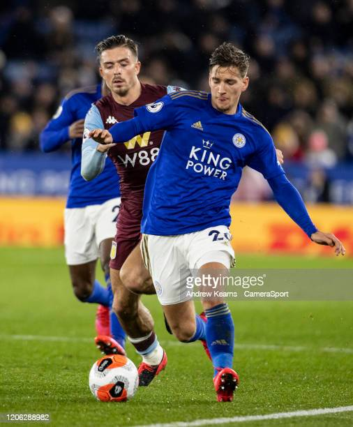 Leicester City's James Justin competing with Aston Villa's Jack Grealish during the Premier League match between Leicester City and Aston Villa at...