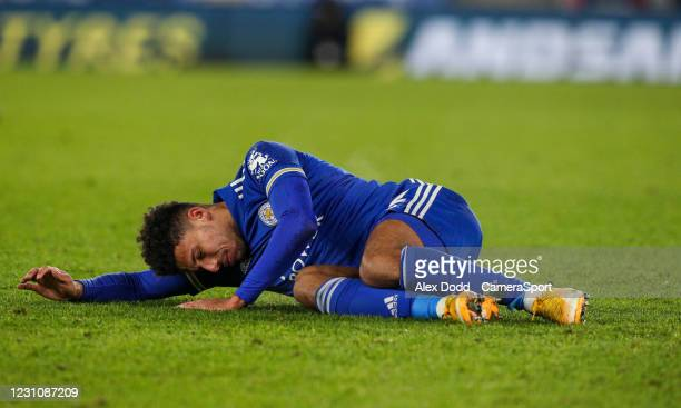 Leicester City's James Justin is injured during the Emirates FA Cup Fifth Round match between Leicester City and Brighton And Hove Albion at The King...