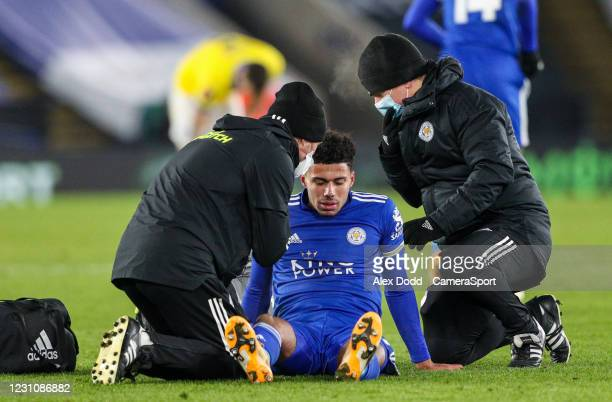 Leicester City's James Justin receives treatment during the Emirates FA Cup Fifth Round match between Leicester City and Brighton And Hove Albion at...