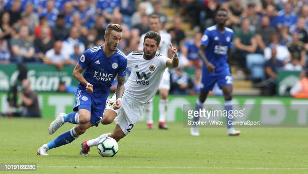 Leicester City's James Maddison and Wolverhampton Wanderers' Joao Moutinho during the Premier League match between Leicester City and Wolverhampton...