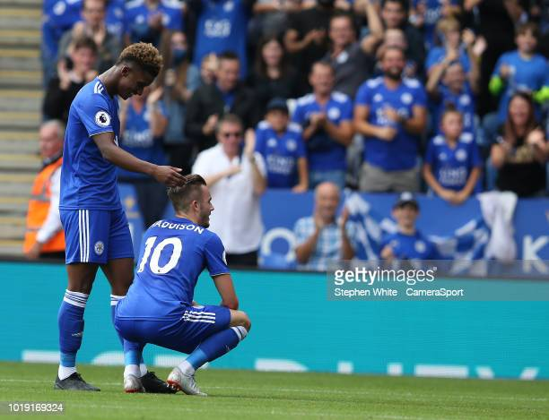 Leicester City's James Maddison celebrates scoring his side's second goal with teammate Demarai Gray during the Premier League match between...